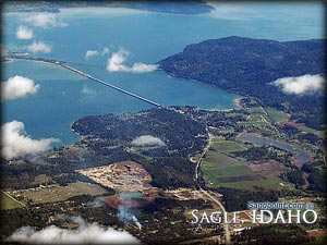 An aerial view of Sagle Idaho, with Lake Pend Oreille and the long bridge connecting to Sandpoint. Sagle is a beautiful town complete with numerous activities such as hiking, mountain biking, hunting and fishing!